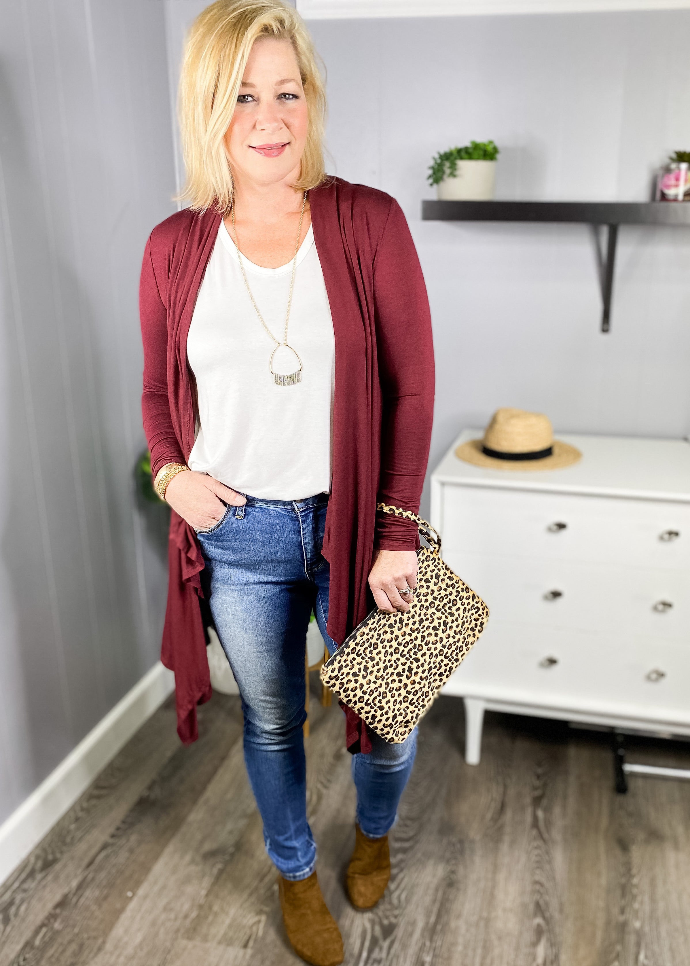 Lightweight cardigan with open front available in wine and olive, shown with our leopard wristlet, at L.E & CO Boutique.