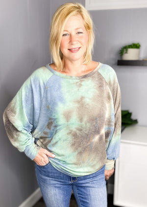 Tie Dye dolman sleeve is pretty fall colors available online at L.E & CO Boutique