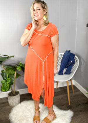 Soft jersey knit dress in a beautiful coral. Click to see all available dresses at L.E & CO boutique, an inline boutique for women based out of Troy, Michigan