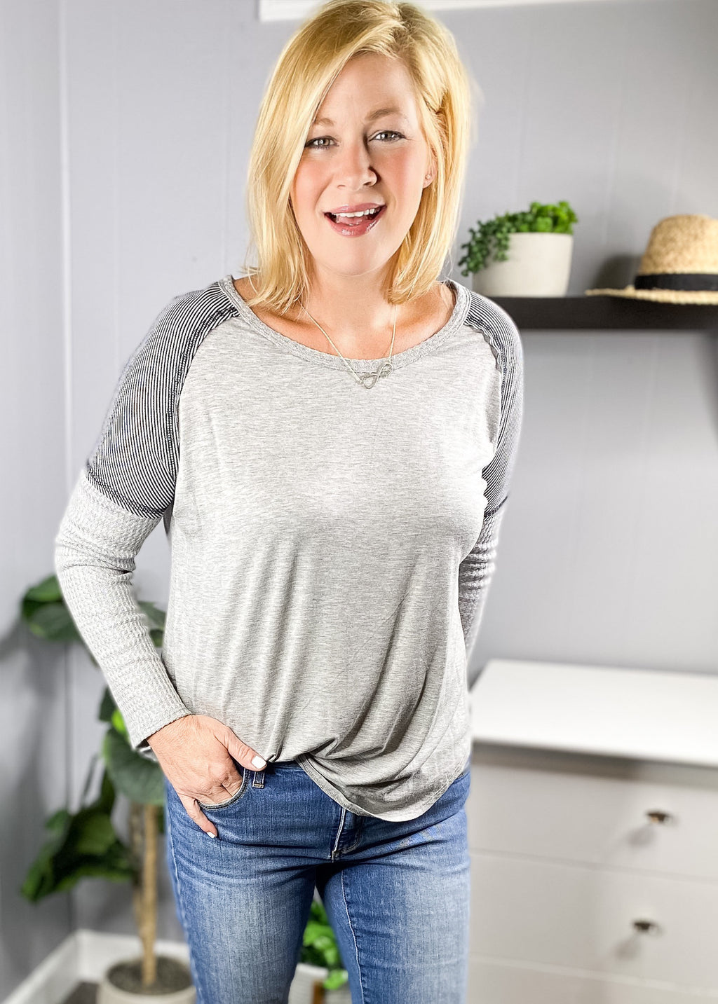 Everyday top in gray with pinstriped shoulders and waffle knit sleeves at L.E & CO Boutique