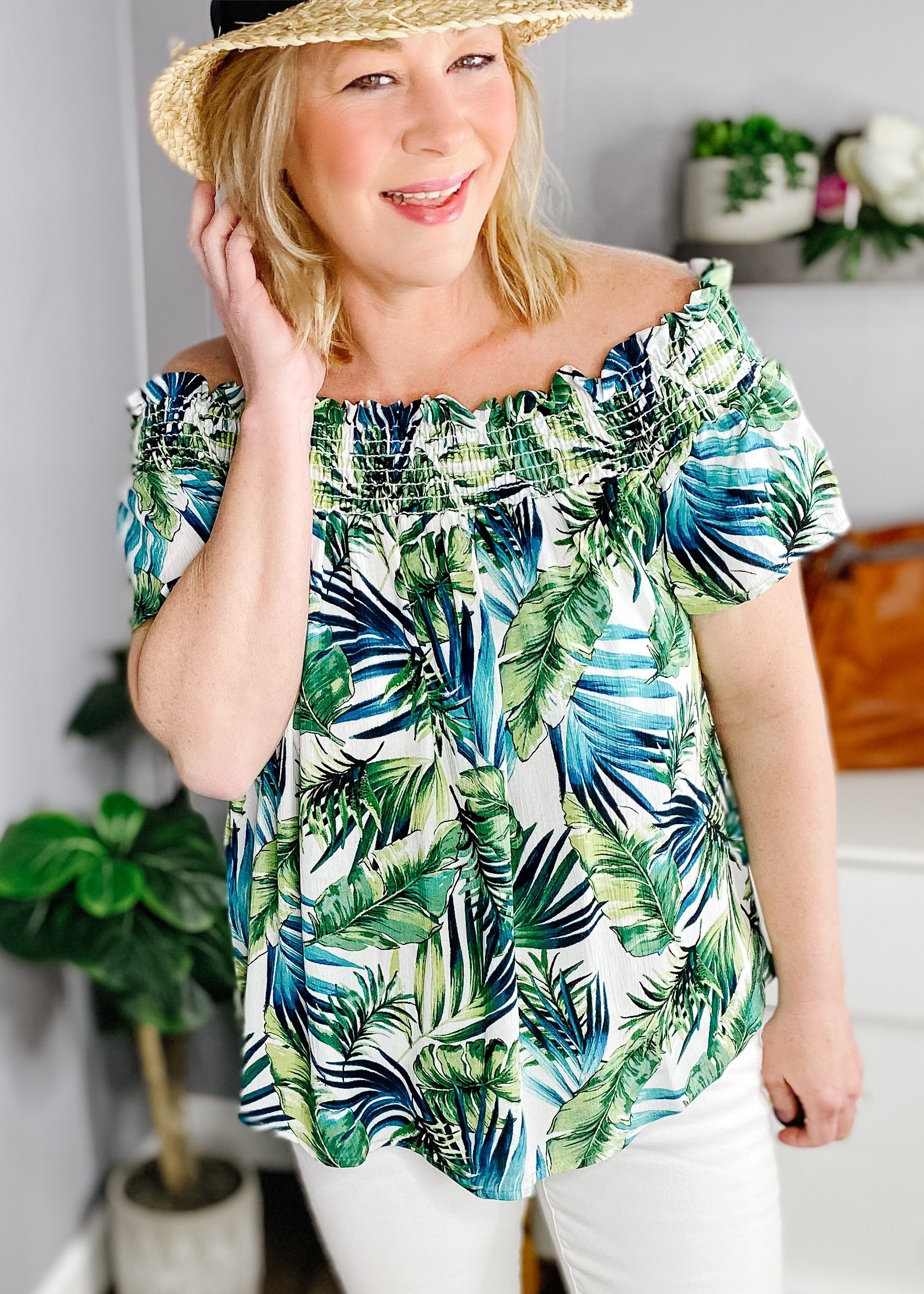 Smocked tropical off the shoulder top. Stunning blues and greens tropical pattern, short sleeves and soft flowy fabric.