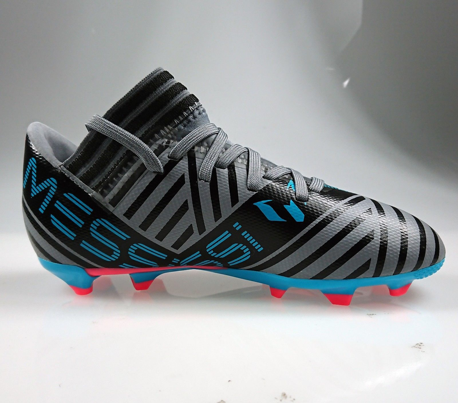 f9f126eeb6de ... Adidas Nemeziz Messi 17.3 FG Junior Grey Soccer Cleats ...
