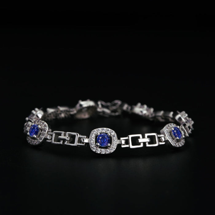 Seven Stone 3 Carat Round Cut Diamond Accent Frame and Sapphire Station Bracelet in White Gold