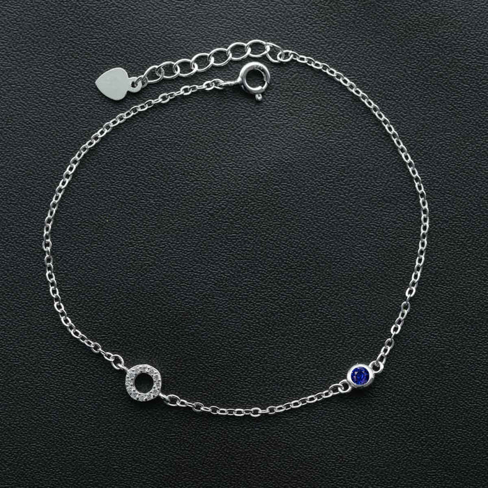 Single Ring Shape 0.25 Carat Round Cut Diamond and Bezel Set Sapphire Link Bracelet in White Gold