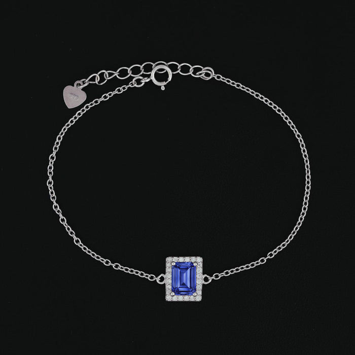 Fancy 1 Carat Emerald Cut Sapphire and Diamond Halo Link Bracelet in White Gold