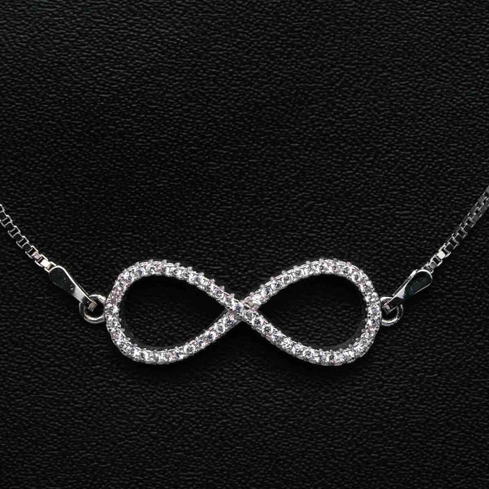 Infinity Twisted Shape 0.25 Carat Round Cut Diamond Chain Bracelet in White Gold
