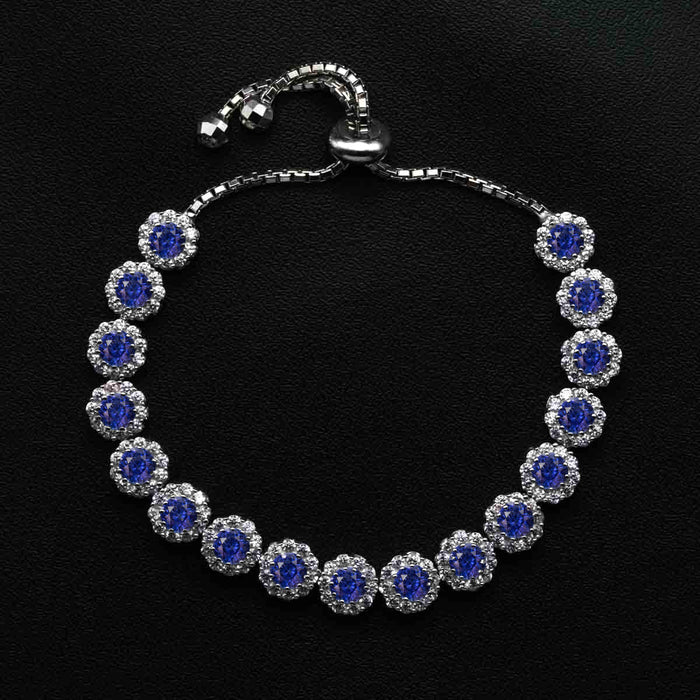 Flower Shaped 10 Carat Round Cut Diamond and Sapphire Bolo Bracelet in White Gold