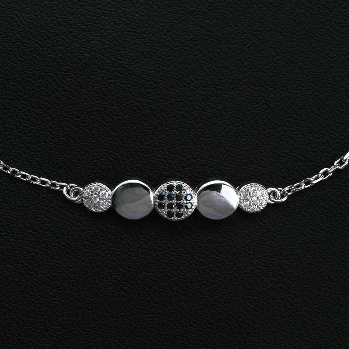 Five Circle Shaped 0.25 Carat Round Cut Black and White Diamond Chain Bracelet in White Gold