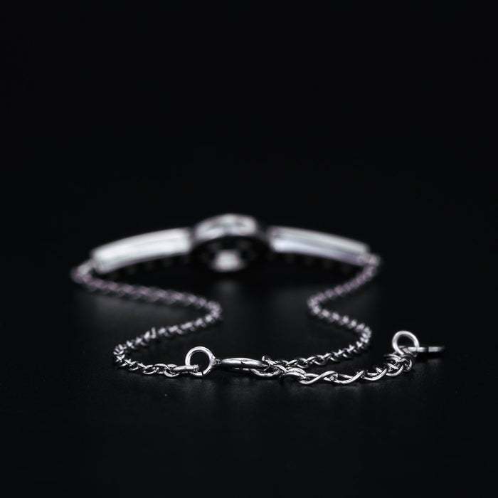 Split Circle Shape 0.50 Carat Round Cut Channel Set Black and White Diamond Link Bracelet in White Gold