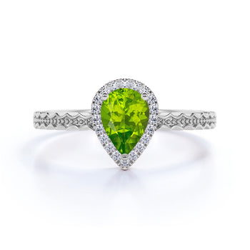 Wave Design 1.50 Carat Pear Cut Olive Green Peridot and Diamond Zigzag Engagement Ring in White Gold
