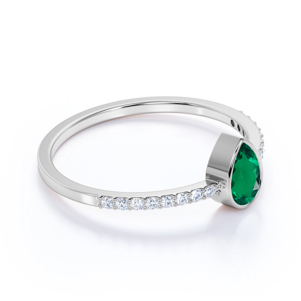 Petite Bezel Set Teardrop Emerald and Fishtail Diamond Engagement Ring in White Gold