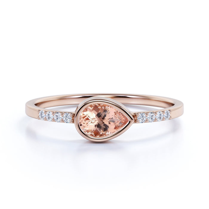 Dainty Bezel Set 0.75 Carat Pear Peachy Pink Morganite and Diamond East West Engagement Ring in Rose Gold