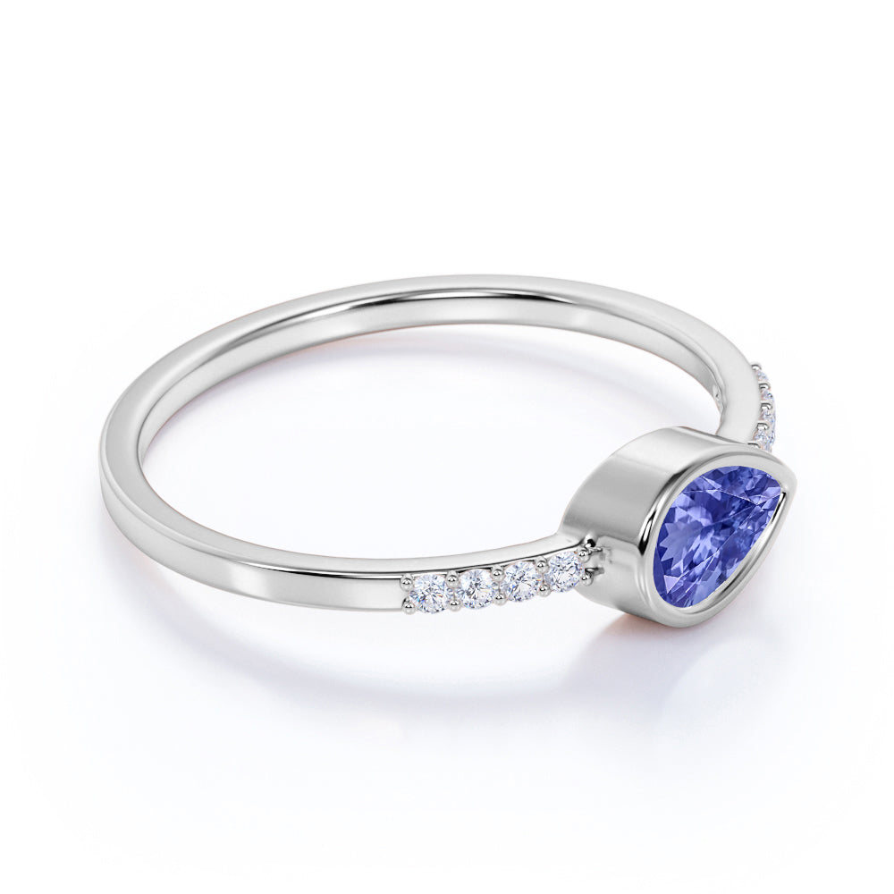 Dainty Bezel 0.75 Carat Pear Blue Violet Tanzanite and Diamond East West Engagement Ring in White Gold