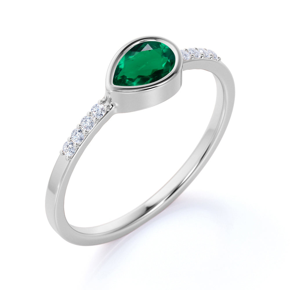 Dainty Bezel 0.75 Carat Pear Emerald and Diamond East West Engagement Ring in White Gold