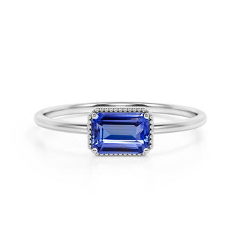 Horizontal 1.75 Carat Emerald Cut Violet Tanzanite and Modern Solitaire Engagement Ring in White Gold