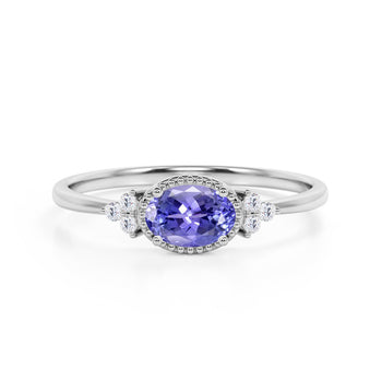 Unique East West 1.40 Carat Oval Cut Peacock Tanzanite and 7 Stone Diamond Engagement Ring in White Gold