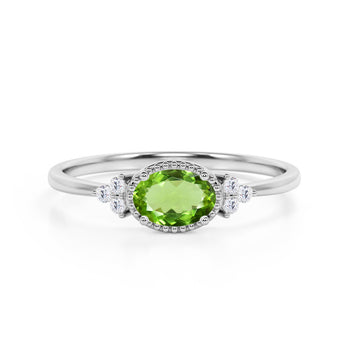 Unique East West 1.40 Carat Oval Cut Peridot and 7 Stone Diamond Engagement Ring in White Gold