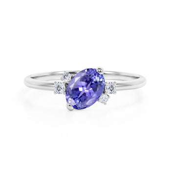 Unique 1.85 Carat Oval Cut Blue Tanzanite and Diamond Asymmetrical Engagement Ring in White Gold
