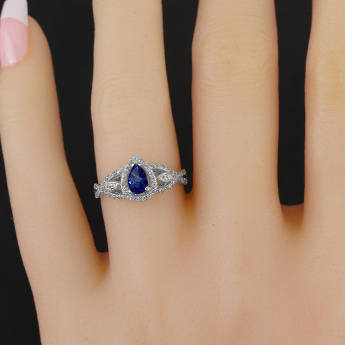 Infinity 1.75 Carat Pear Shape Tanzanite and Diamond Vintage Twisted Engagement Ring in White Gold