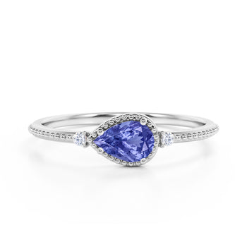 Sideways 1.10 Carat Pear Blueberry Tanzanite and 3 Stone Diamond Elegant Engagement Ring in White Gold