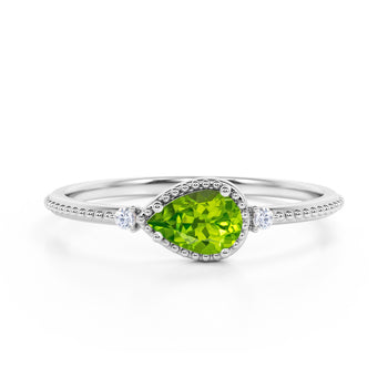 Sideways 1.10 Carat Pear Peridot and 3 Stone Diamond Elegant Engagement Ring in White Gold
