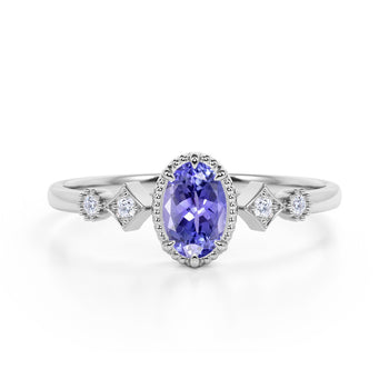 Beautiful 1.10 Carat Oval Shape Peacock Tanzanite and 5 Stone Diamond Milgrain Engagement Ring in White Gold