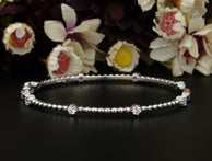 4 Carats Bow Tie Designer Bangle Bracelet for Women in Sterling Silver