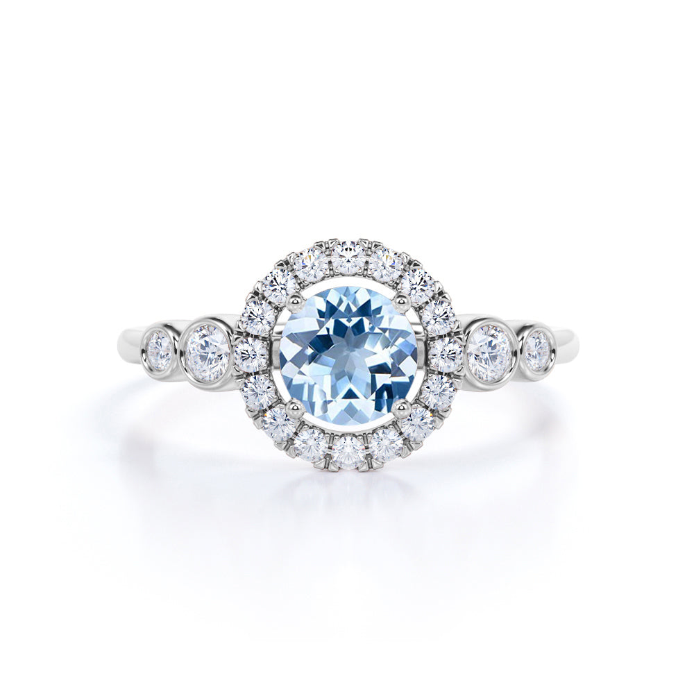 Modern Halo 1.50 Carat Round Cut Deep Ocean Blue Aquamarine and Diamond Bezel set Engagement Ring in White Gold