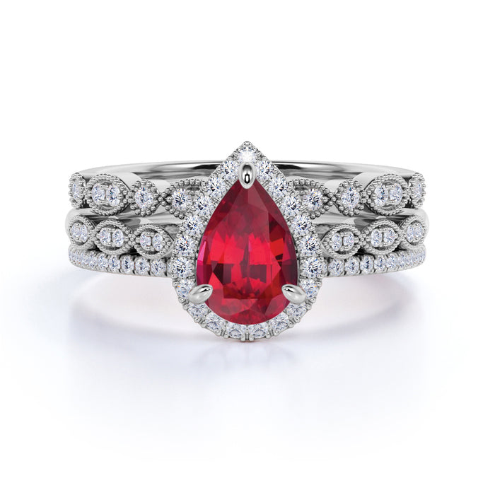 Classic Pave 2.50 Carat Pear Shape Ruby and Diamond Halo Trio Bridal Set with Art Deco Bands in White Gold