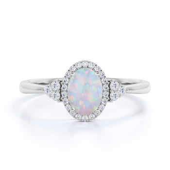 3 stone 1.50 Carat Oval Cut Fire Opal and Diamond Twisted Engagement Ring in White Gold