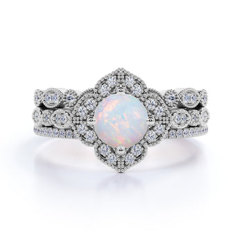 Twisted 2.25 Carat Round Fire Opal and Halo Diamond Trio set with Crown Bands in White Gold