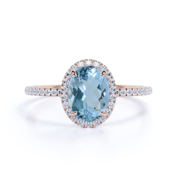 1.25 Carat oval cut Aquamarine and Diamond Halo Wedding Ring in Rose Gold