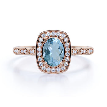 1.50 Carat oval cut Aquamarine and Diamond Engagement Ring in Rose Gold
