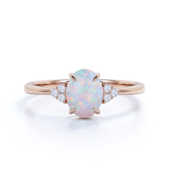 1.50 Carat Oval Cut Fire Opal and 6 stone Diamond Engagement Ring in Rose Gold
