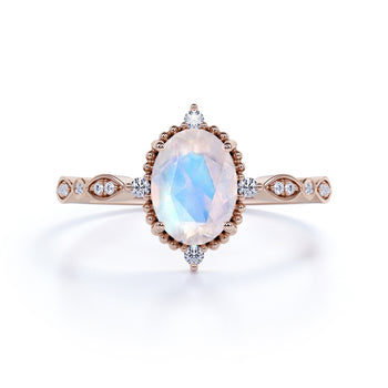 Vintage Inspired 1.25 Carat Oval Cut Rainbow Moonstone and Diamond Engagement Ring in Rose Gold