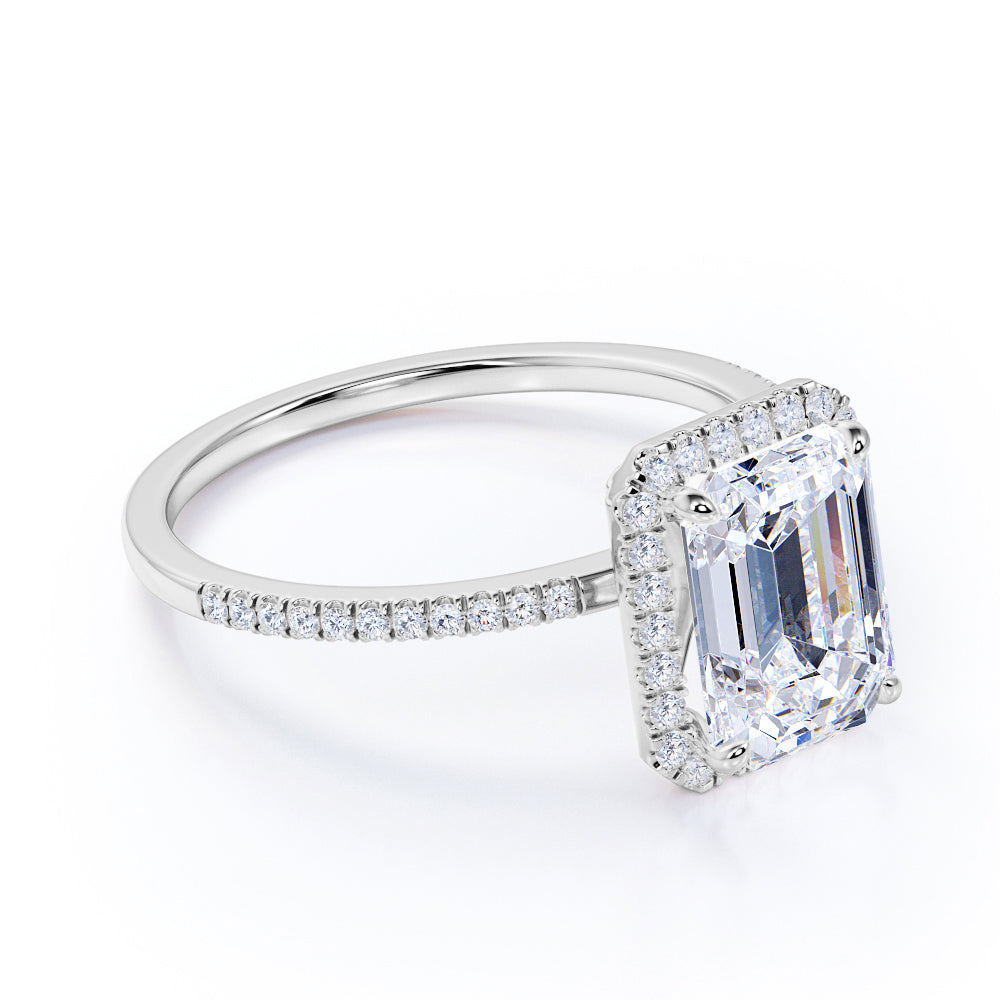 1.50 Carat emerald cut Moissanite and Diamond Halo Engagement Ring in 10k White Gold