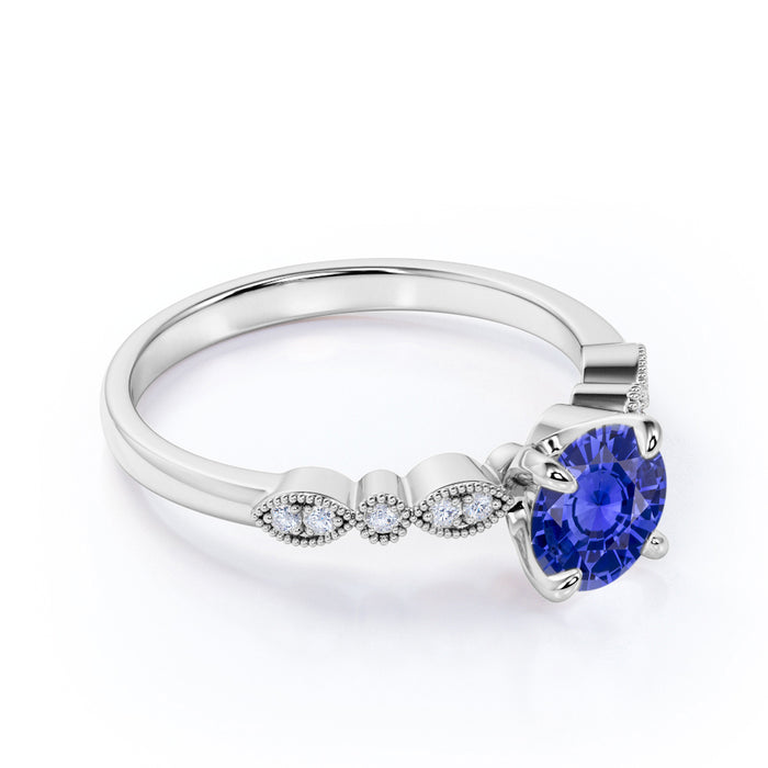 Art Deco 1.20 Carat Round Cut Sapphire and Four Stone Diamond Engagement Ring in White Gold