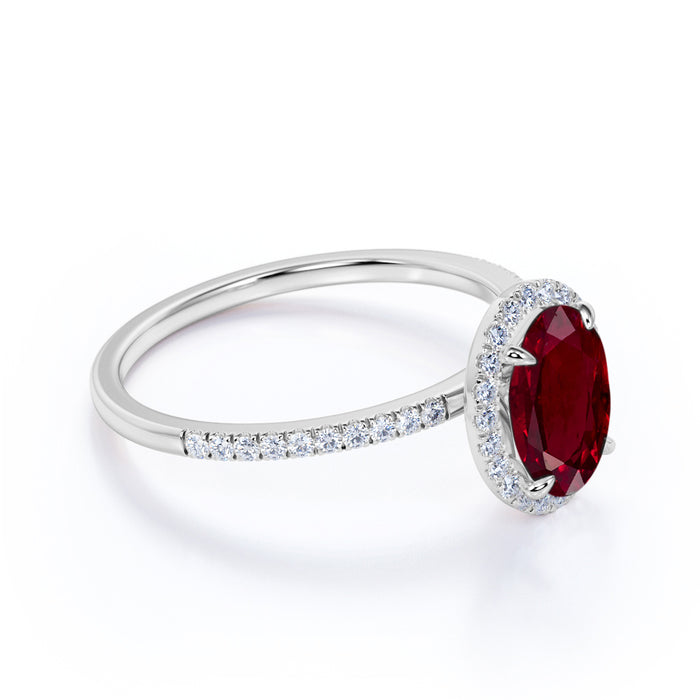 Antique Design 1.50 Carat Oval Cut Ruby and Diamond Halo Engagement Ring in White Gold