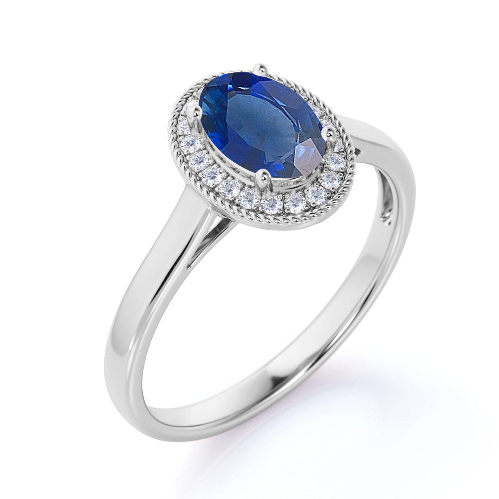 Antique 1.50 Carat Oval cut Sapphire and Diamond Halo Engagement Ring in White Gold