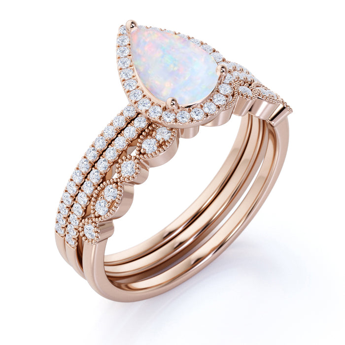 Art Deco Vintage 2.25 Carat Pear Shape Ethiopian Opal and Diamond Halo Trio Bridal Set in Rose Gold