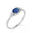 Bezel Set 1.20 Carat Oval Cut Sapphire and Six Stone Diamond Engagement Ring in White Gold
