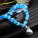 "Bracelet "" attraction d'argent "" pierre oeil de chat bleu"