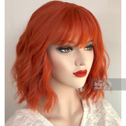 "Lola | 12"" Orange Wavy Bob Synthetic Wig with Bangs Her Wig Closet"