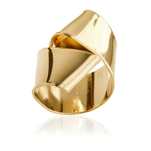 Bowtie is a hand formed ribbon resembling pasta that wraps around your finger.  It is fabricated in brass and finished in 14k gold plating