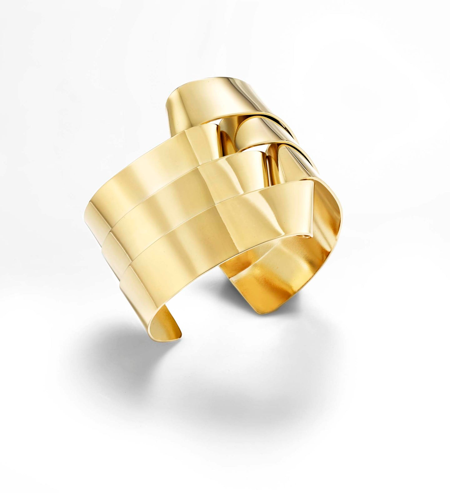 Braid cuff bracelet is hand fabricated in brass and finished with 14k gold plating. It is approximately 1.5