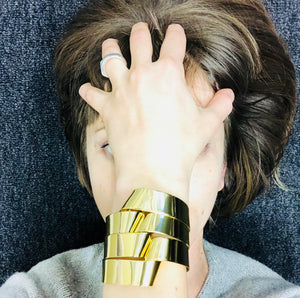 "Braid cuff bracelet is hand fabricated in brass and finished with 14k gold plating. It is approximately 1.5"" wide. Sculptural but light and easily formed on the hand."