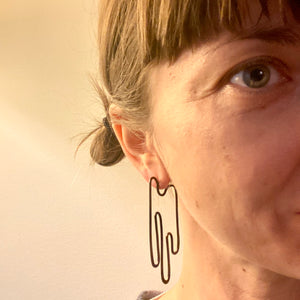 """I am dripping with desire for a new era"" post earrings"