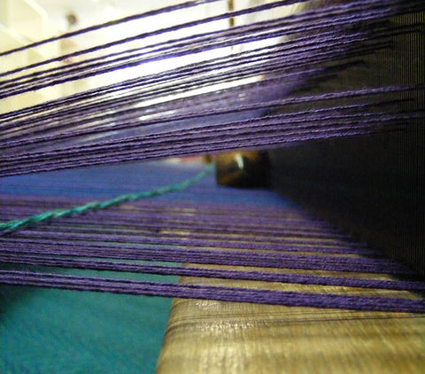 Purple, green and blue strands of 100% Merino wool in Fiadh's Dingle studio