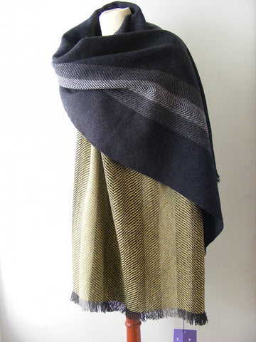 Two handwoven scarves on a dressmaker's dummy - one black and grey and one balck and yellow both handmade by Fiadh