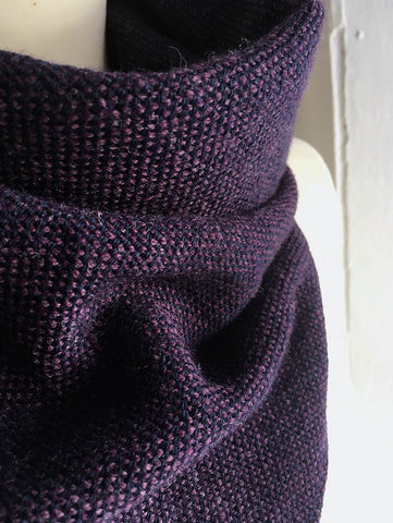 With a loop through system, this super soft 100% merino wool triangle scarf in purple will stay in place when you style it